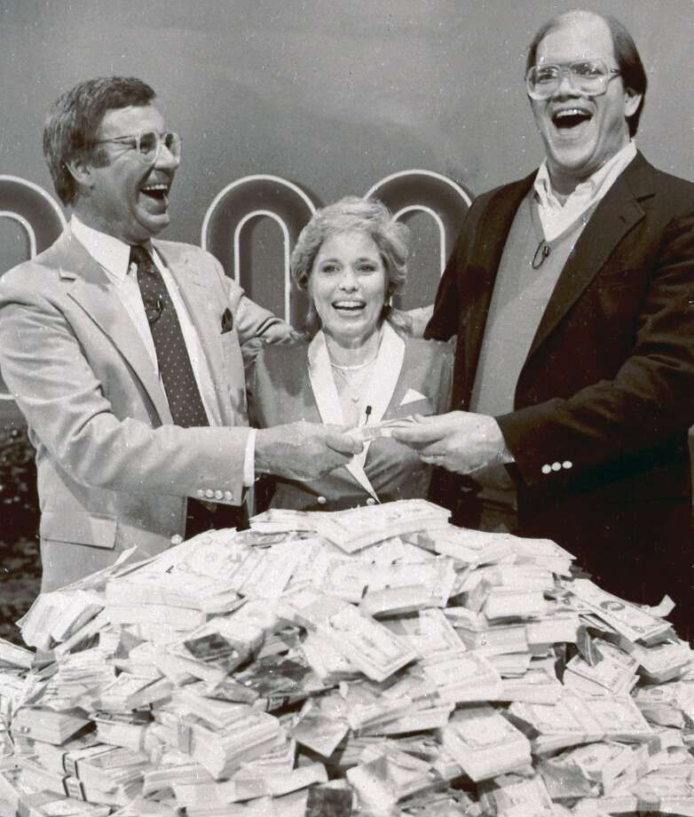 "Jim Lange (left) congratulates Connie and Steve Rutenbar after they won $1 million on ""The $1,000,000 Chance of a Lifetime."" Photo: Associated Press"