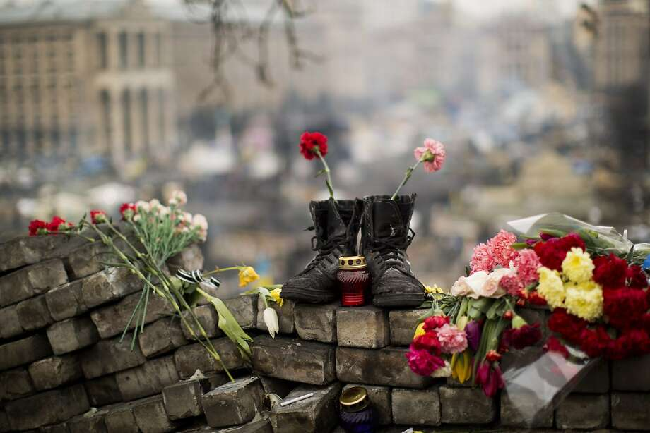 A pair of boots sits on top of a barricade at Independence Square, in Kiev. Police are on high alert after dozens of armed pro-Russia men stormed and seized local government buildings in the Crimea region. Photo: Emilio Morenatti, Associated Press