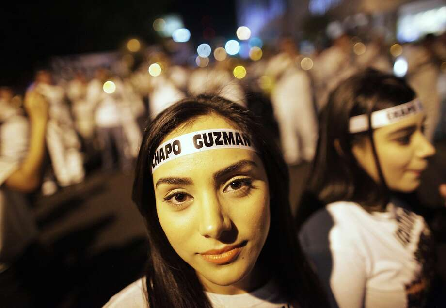 "Young women wear headbands featuring the name of Chapo Guzman during a march in Culiacan February 26, 2014. More than a thousand people marched through the streets of the capital of captured drug lord Joaquin ""Shorty"" Guzman's home state in northwest Mexico on Wednesday, calling for his freedom. Guzman was captured on Saturday in a predawn raid in the beachside resort and fishing center of Mazatlan, around 125 miles (200 km) southeast of Culiacan. Picture taken February 26, 2014.   REUTERS/Daniel Becerril (MEXICO - Tags: DRUGS SOCIETY CIVIL UNREST) Photo: Daniel Becerril, Reuters"