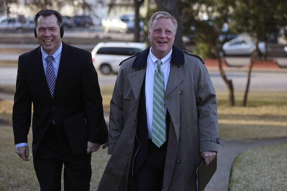 Victor Holmes, left, and Mark Phariss arrive at the John H. Wood Jr. U.S. Courthouse for the hearing for their request for a preliminary injunction to declare Texas' ban on same-sex marriage unconstitutional in San Antonio on Wednesday, Feb. 12, 2014. Photo: Lisa Krantz / San Antonio Express-News