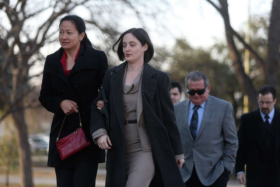 Cleo DeLeon left, and Nicole Dimetman, arrive at the John H. Wood Jr. U.S. Courthouse for the hearing for their request for a preliminary injunction to declare Texas' ban on same-sex marriage unconstitutional in San Antonio on Wednesday, Feb. 12, 2014. The couple legally married in Massachusetts in 2009. Photo: Lisa Krantz / San Antonio Express-News