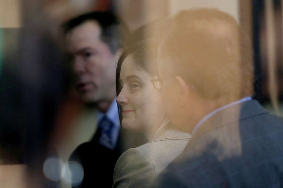 Plaintiff Nicole Dimetman and Victor Holmes, left, wait to go through security for their request for a preliminary injunction to declare Texas' ban on same-sex marriage unconstitutional at the John H. Wood Jr. United States Courthouse in San Antonio on Wednessday, Feb. 12, 2014. Photo: Lisa Krantz / San Antonio Express-News