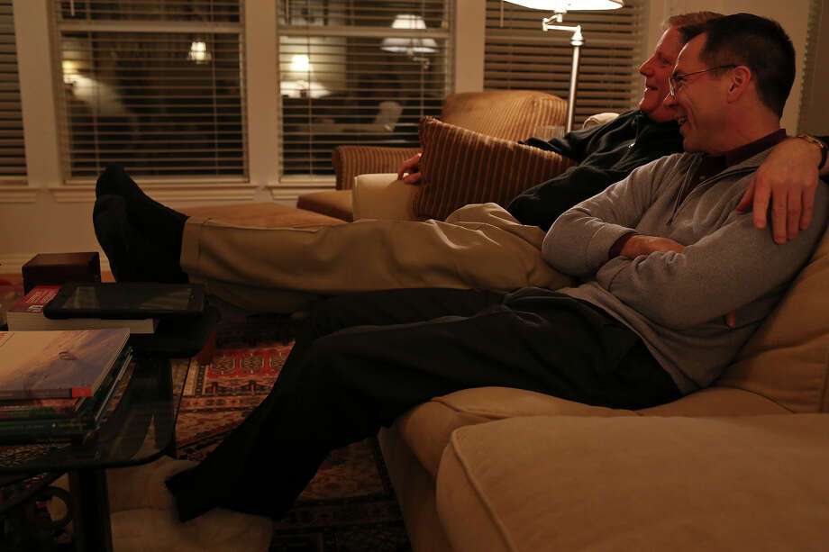 Mark Phariss and Victor Holmes, right, watch a movie at their home in Plano on Friday, Feb. 7, 2014. Photo: Lisa Krantz, San Antonio Express-News / San Antonio Express-News