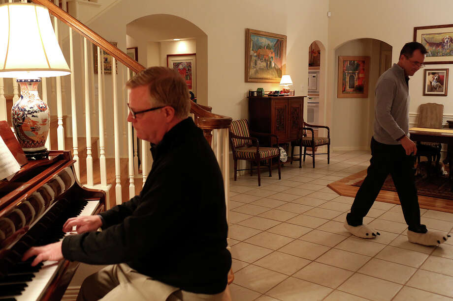 Mark Phariss plays the piano with his partner, Victor Holmes, at their home in Plano on Friday, Feb. 7, 2014. Photo: Lisa Krantz, San Antonio Express-News / San Antonio Express-News
