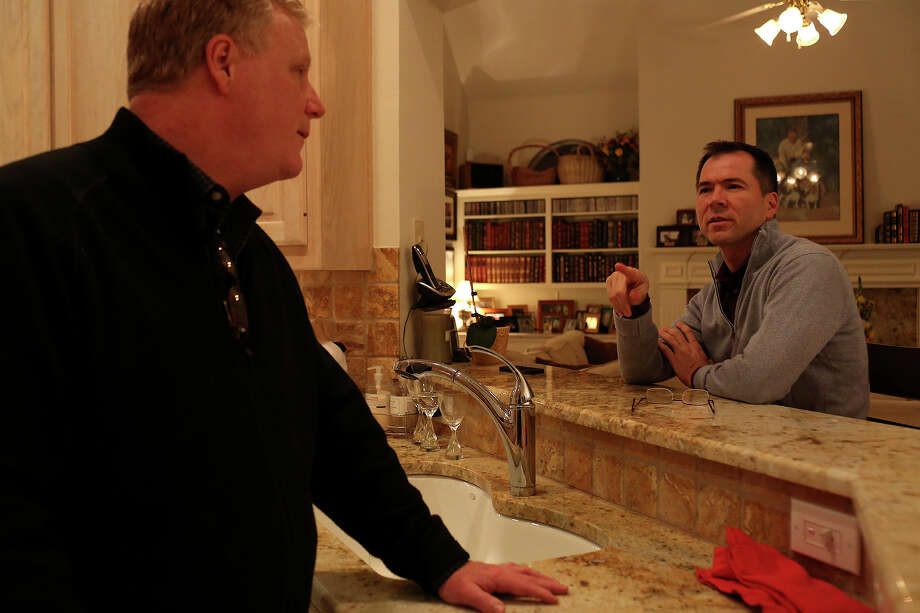 Mark Phariss, left, and Victor Holmes spend the evening at their home in Plano on Friday, Feb. 7, 2014. Photo: Lisa Krantz, San Antonio Express-News / San Antonio Express-News