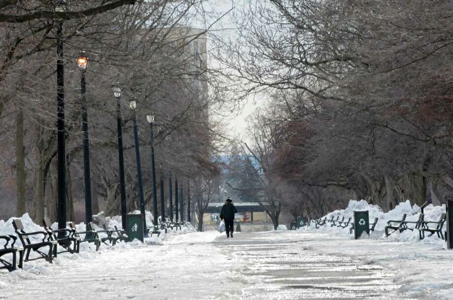 A man walks through Washington Park Thursday, Feb. 27, 2014, in Albany, N.Y.  (Lori Van Buren / Times Union) Photo: Lori Van Buren / 00025939A