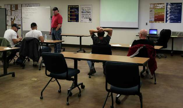 David Hooper, a safety trainer for Robinson Drilling, speaks with employees during a safety class in Big Spring.  Photo: James Nielsen, Houston Chronicle / © 2013  Houston Chronicle