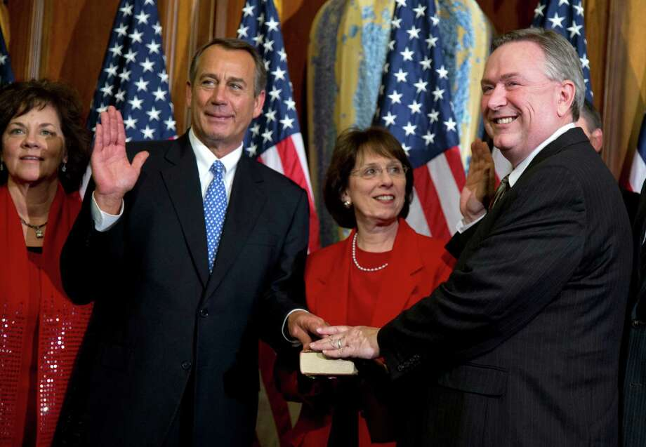 FILE - In this Jan. 3, 2013, file photo, Rep. Steve Stockman, R-Texas, right, participates in a mock swearing-in ceremony with Speaker of the House Rep. John Boehner, R-Ohio, for the 113th Congress in Washington. Stockman, a suburban Houston Republican is mounting a long-shot challenge from the right against Senate minority whip John Cornyn but has made virtually no public appearances in Texas as questions mount about his campaign finances. Now, he's stopped showing up for his day job, too. (AP Photo/ Evan Vucci, File) Photo: Evan Vucci, STF / AP