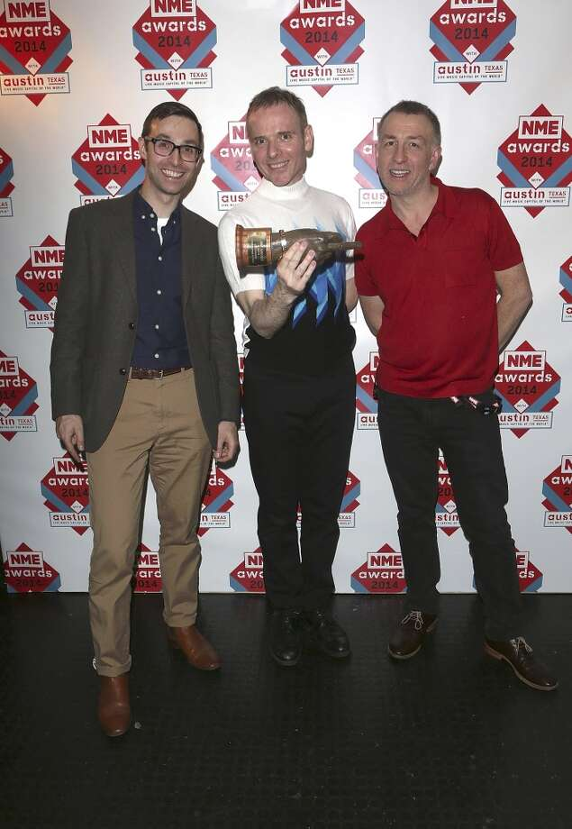 Belle and Sebastian pose in the winners room with their award for their Outstanding Contribution to Music at the annual NME Awards at Brixton Academy on February 26, 2014 in London, England. Photo: Tim P. Whitby, Getty Images
