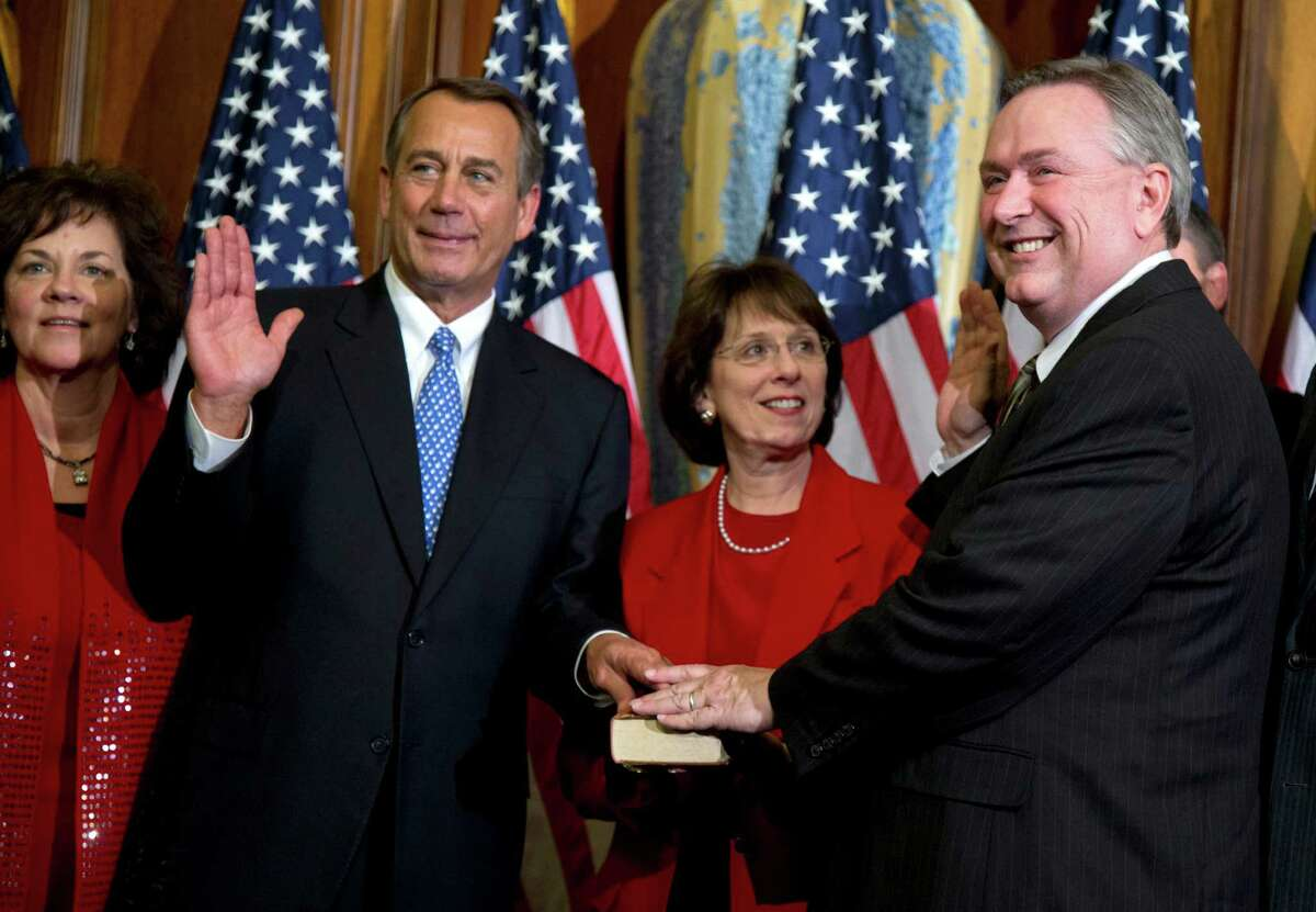 FILE - In this Jan. 3, 2013, file photo, Rep. Steve Stockman, R-Texas, right, participates in a mock swearing-in ceremony with Speaker of the House Rep. John Boehner, R-Ohio, for the 113th Congress in Washington. Stockman, a suburban Houston Republican is mounting a long-shot challenge from the right against Senate minority whip John Cornyn but has made virtually no public appearances in Texas as questions mount about his campaign finances. Now, heÂ?'s stopped showing up for his day job, too. (AP Photo/ Evan Vucci, File)