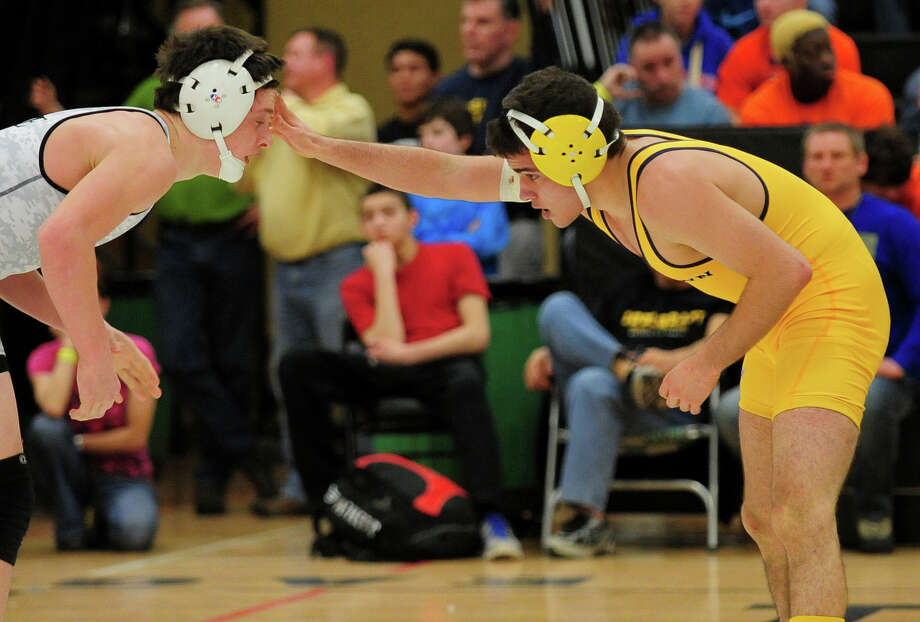 Newtown's James Leuci, right, wrestles against Ridgefield's Kevin Side, during CIAC Class LL Wrestling Championship action at Trumbull High School on Saturday February 22, 2014. Newtown took home the championship trophy for the first time in its history. Photo: Christian Abraham / Connecticut Post