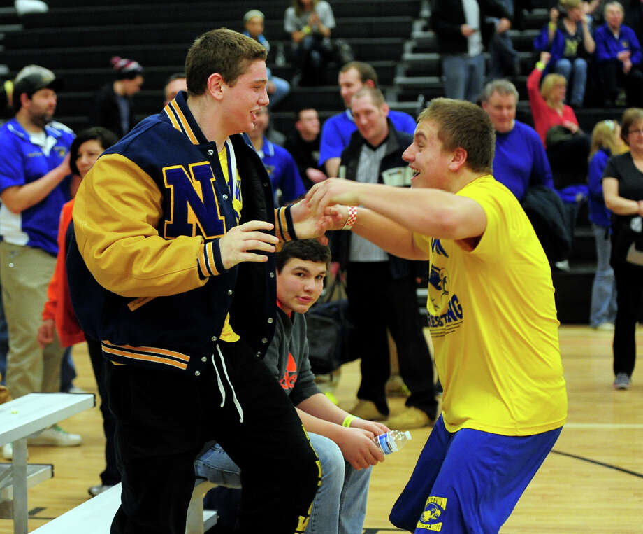 Newtown's Andy Hubina, left, and teammate Thomas Long, reacts after the official word that the team has won the CIAC Class LL Wrestling Championship at Trumbull High School on Saturday February 22, 2014. This is the first time in the school's history that it has won this event. Photo: Christian Abraham / Connecticut Post