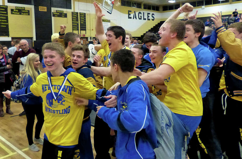 Newtown reacts after winning the CIAC Class LL Wrestling Championship at Trumbull High School on Saturday February 22, 2014. This is the first time in the school's history that it has won this event. Photo: Christian Abraham / Connecticut Post
