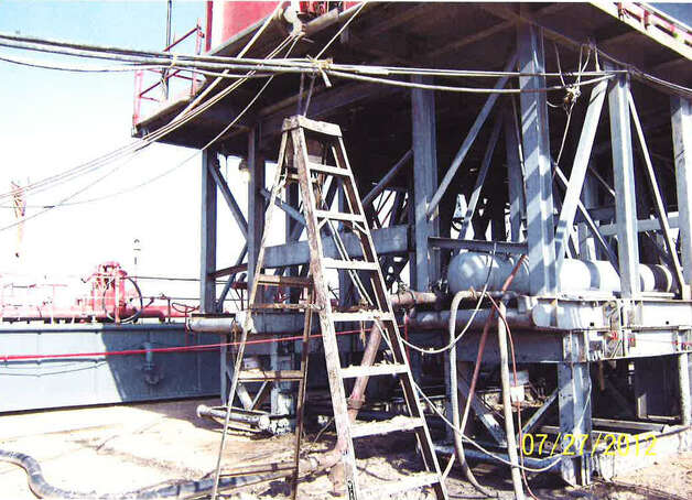 This photo is of a Robinson Drilling rig site near Big Lake, Texas; this is the ladder where Chase Dillon was standing when he was fatally injured while using a knife to cut a piece of rope that held electrical cables to the rig. He was shocked and died from injuries he received when he fell from the ladder. Photos: Reagan County Sheriff's Office.  For Lise Olsen Oil Patch Deaths -- Day 2. Photo: Reagan County Sheriff's Office / Reagan County Sheriff's Office