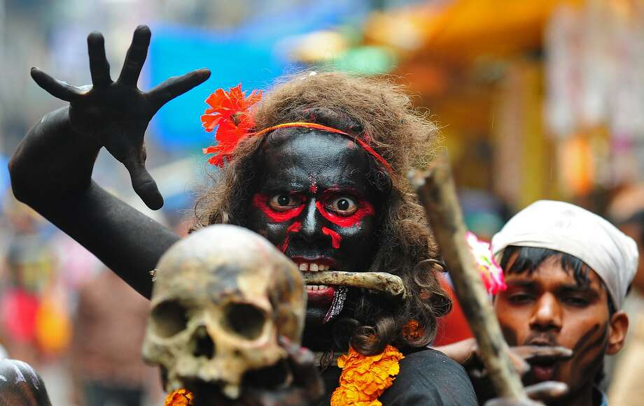 Alas, poor Yorick! An Indian Hindu devotee brandishes a human skull during a procession for Maha Shivaratri, dedicated to the Hindu god Lord Shiva, in Allahabad. Hindus mark the Maha Shivratri festival by offering special prayers and fasting to Lord Shiva, the god of 