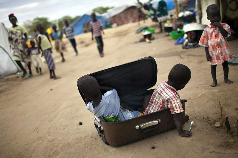 The boys in the baggage:With no toys or playground, children in a refugee camp for the Nuer ethnic group in Bor, South Sudan, have to amuse themselves with whatever they can find - an empty suitcase, for example. Nearly 900,000 people have been forced from their homes in recent fighting between rebel and government forces. Photo: JM Lopez, AFP/Getty Images