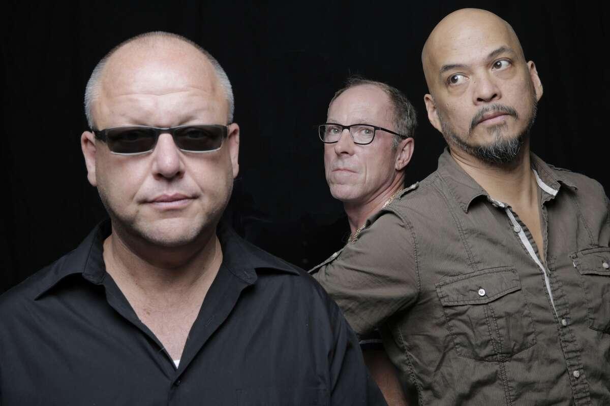 The Pixies, L-R: Black Francis, David Lovering, Joey Santiago(Credit: Michael Halsband)