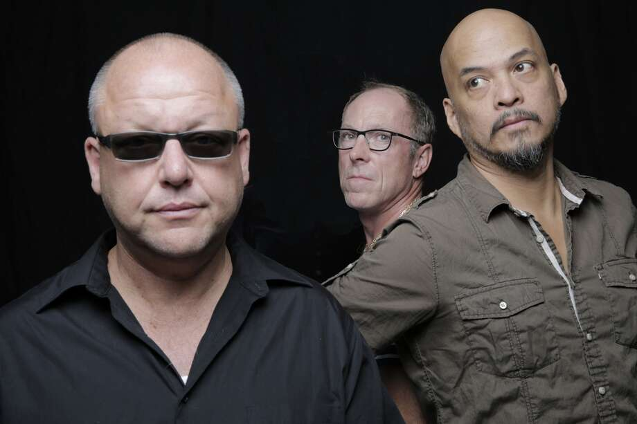 The Pixies, L-R: Black Francis, David Lovering, Joey Santiago(Credit: Michael Halsband)