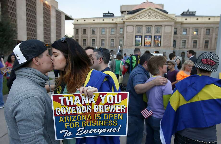 Arizona comes to its senses:Rachel Butas and Jo Jo Halko kiss after hearing that Arizona Gov. Jan Brewer vetoed a 