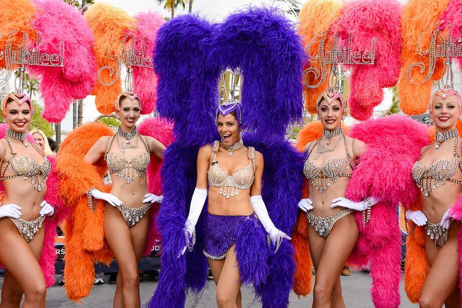 Just met a showgirl named Maria: Extra host Maria Menounos dresses up as a showgirl to celebrate the partnership of 