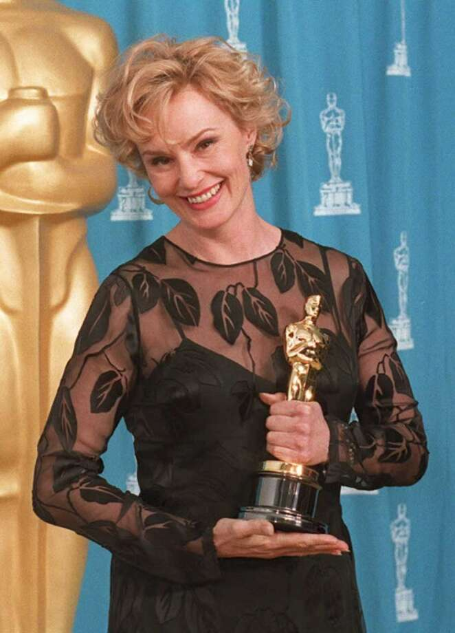 "Jessica Lange holds the Oscar she won for her role as Carly Marshall in the film ""Blue Sky"" in 1995. Photo: DAN GROSHONG, AFP/Getty Images"