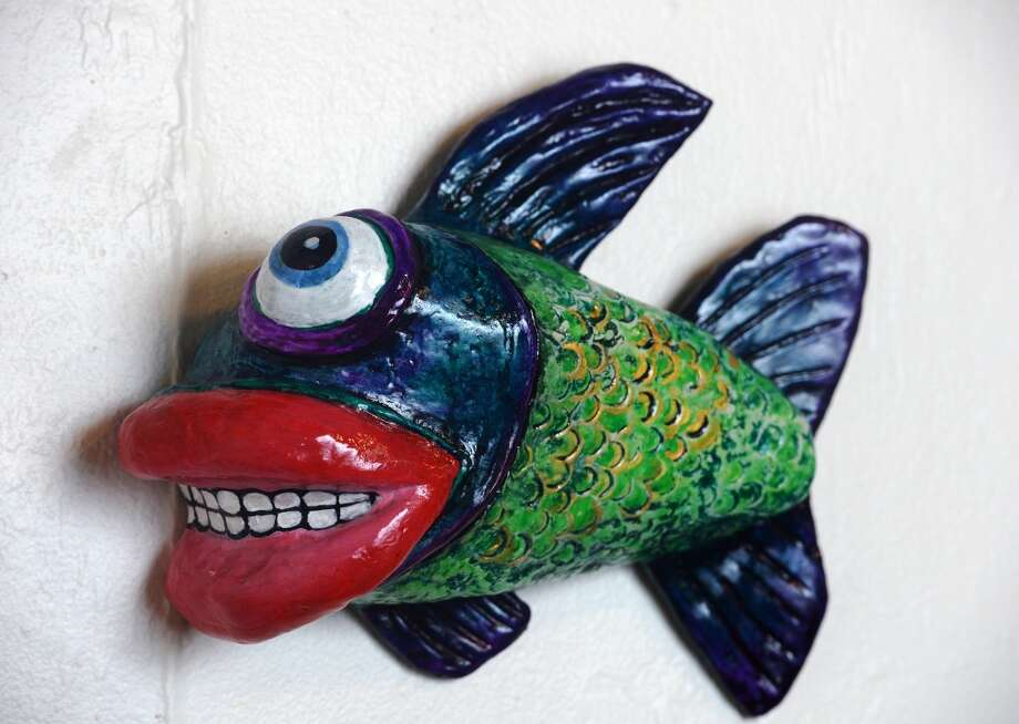"Pictured is part of a diptych, ""Live Fish, Dead Fish"" by Karen Dumesnil and Andy Ledesma. The Art Studio, Inc., is preparing for their Acquae Obscurae show that will begin its run in March. The show will contain pieces representing ""a menagerie of Neches River critters"" in various mediums. Photo taken Wednesday, 2/19/14 Jake Daniels/@JakeD_in_SETX"