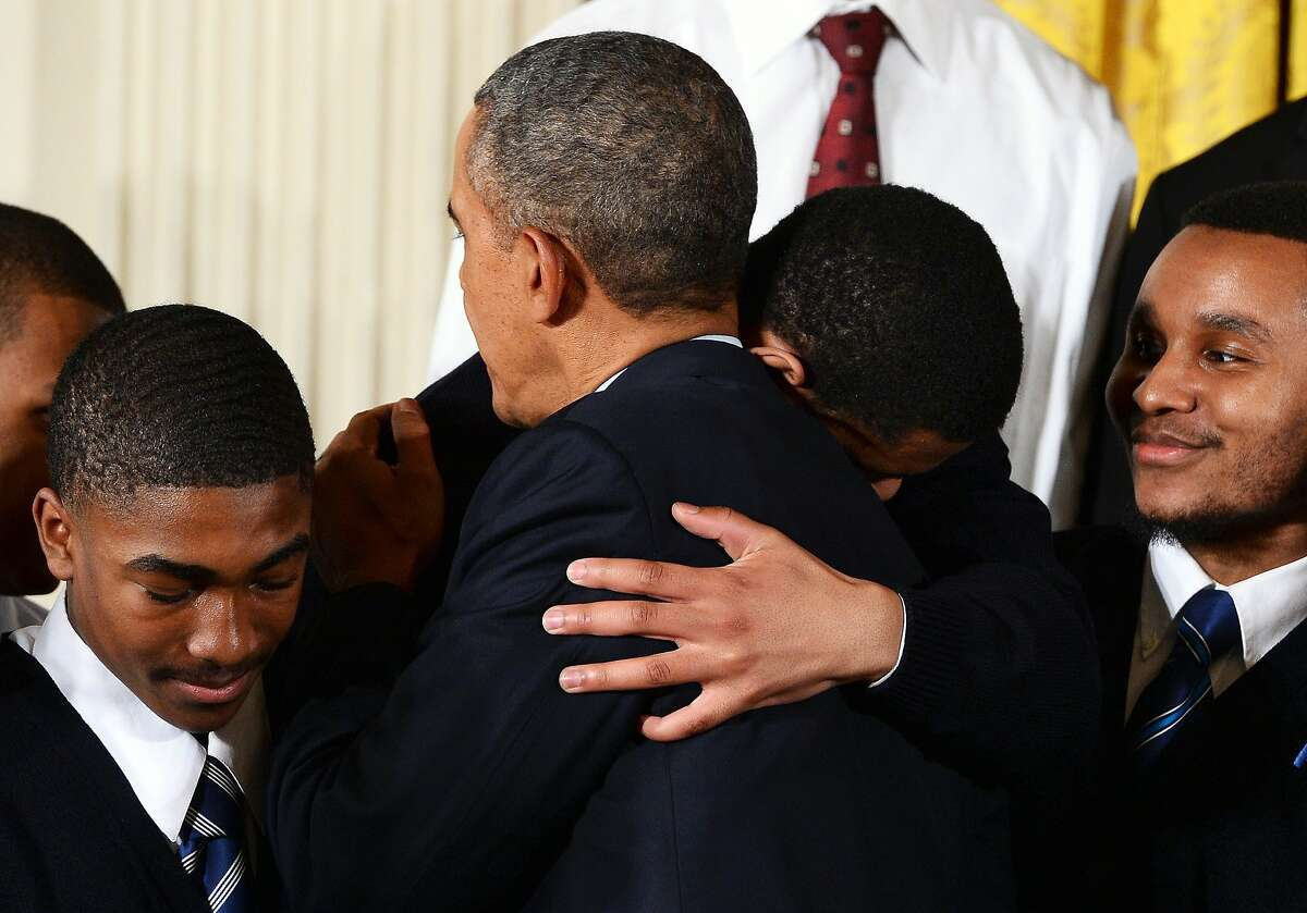 US President Barack Obama is embraced by a young black men after speaking on his My Brothers Keeper initiative to expand opportunity for Americans in the East Room at the White House on February 27, 2014 in Washington, DC. Obama launched a personal quest that will outlast his presidency to help young American men of color survive and prosper despite deprived violent inner city environments where many grow up. AFP PHOTO/Jewel SamadJEWEL SAMAD/AFP/Getty Images