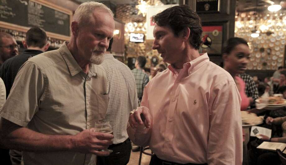 Doug Odell, left, founder of Odell Brewing Co. of Fort Collins, Colo., speaks with Jake Everett during a promotional stop at the downtown Flying Saucer Tuesday night. The 25-year-old brewery is now available in Texas as of this week. ( James Nielsen / Houston Chronicle ) Photo: James Nielsen, Houston Chronicle