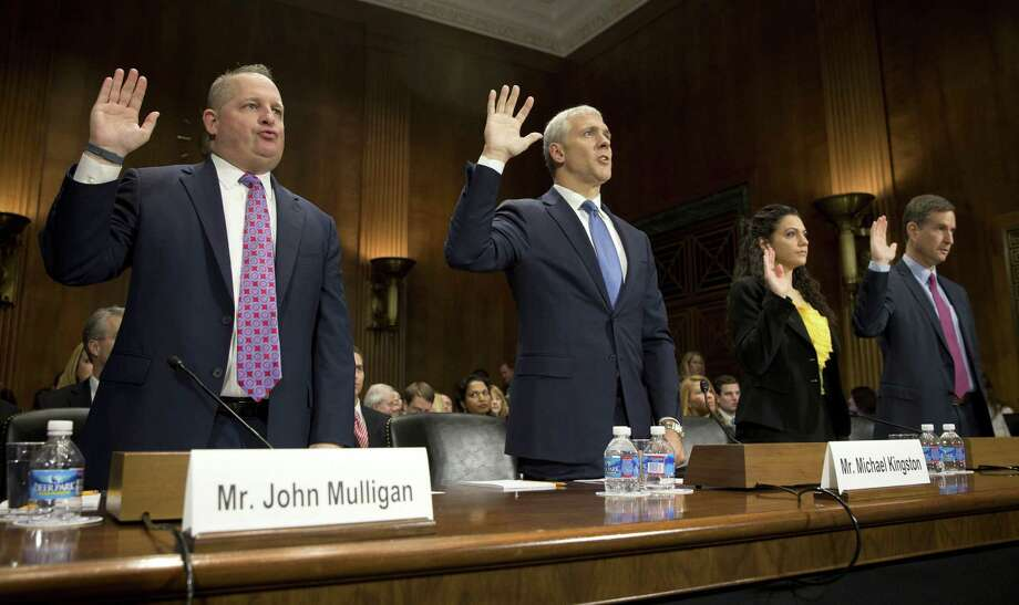 Executives (from left) John Mulligan of Target, Michael Kingston of Neiman Marcus, Delara Derakhshani of the Consumers Union and Fran Rosch of Symantec take the oath before the Senate Judiciary Committee focused on credit card data leaks. Photo: Stephen Crowley / New York Times / NYTNS