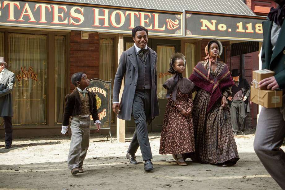 "In the film ""12 Years a Slave,"" Kelsey Scott, as Anne Northup, and children Quvenzhane Wallis, as Margaret, and Cameron Zeigler, as Alonzo, are seen boarding a carriage outside their home in Saratoga Springs with their father Solomon, portrayed by Chiwetal Ejiorfor, and outside the United States Hotel on Broadway, where Northup played the violin and Anne sometimes cooked, according to his memoir. (Courtesy of Fox Searchlight) Photo: Jaap Buitendijk / Digital / 35mm"