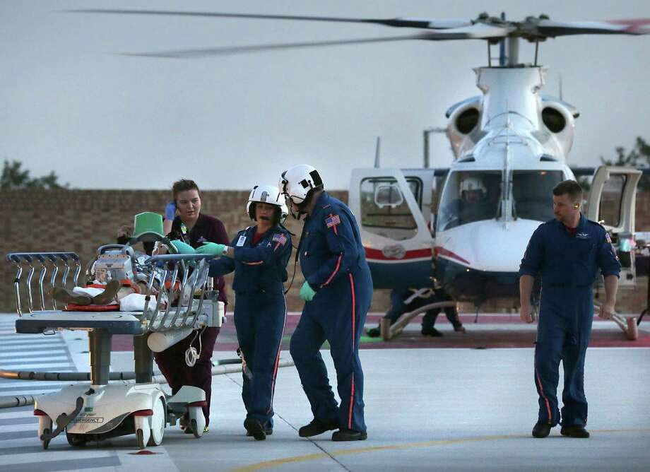 Air Life medical personnel transport a patient from their helicopter to University Health System Hospital. An article on increased accidents in the Eagle Ford Shale was condemned by a reader as anti-capitalism. Photo: Bob Owen / San Antonio Express-News / © 2012 San Antonio Express-News