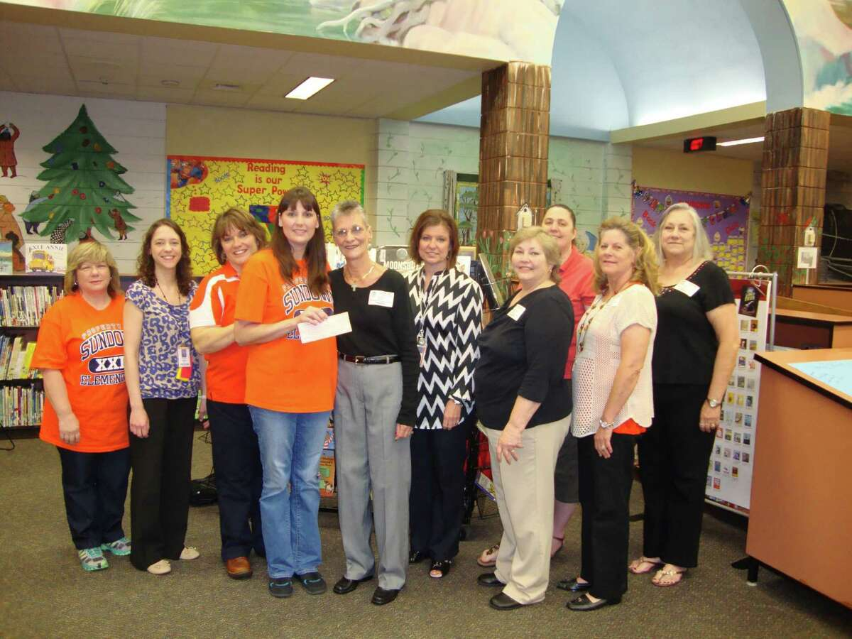 Katy First United Methodist Church donated funds to Sundown Elementary. Participating in the donation were, from left, Donna Long, library aide; Anastasia Khramov, counselor; Kelly Conway, instructional coach; Crystal Matovich, librarian; Judy Lee, First United Methodist Church; Shelly Zaruba, instructional coordinator; Pamela Cline, FUMC; Kelli Onda, instructional coach; Lisa Hinks, FUMC; and Nancy Condry, FUMC. Not pictured is Zelda Bogash of FUMC.