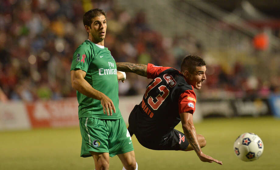Scorpions player Borja Rubiato (13) and Cosmos Carlos Mendes go after the ball during a match last fall  at Toyota Field. The game of soccer moves faster than it appears from the stands. Photo: Robin Jerstad, For The Express-News / San Antonio Express-News