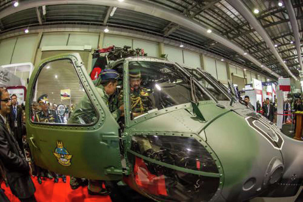 The Sultan of Brunei inspects a Sikorsky S-70i(TM) BLACK HAWK helicopter during the Brunei International Defence Exhibition. The Royal Brunei Air Force is taking delivery of 12 S-70i aircraft through the end of 2014. Equipped with a suite of advanced avionics and sensors, the multirole aircraft will perform a variety of missions over land and water, including search and rescue, humanitarian relief, anti-piracy, troop transport and medical evacuation. (PRNewsFoto/Sikorsky Aircraft)