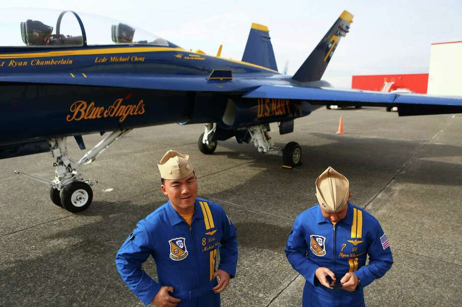 Lt. Cdr. Michael Cheng and Lt. Ryan Chamberlain stand on the flight line as Blue Angels airplane number seven makes a stop in Seattle on Thursday, February 27, 2014 at Boeing Field. Photo: JOSHUA TRUJILLO, SEATTLEPI.COM / SEATTLEPI.COM