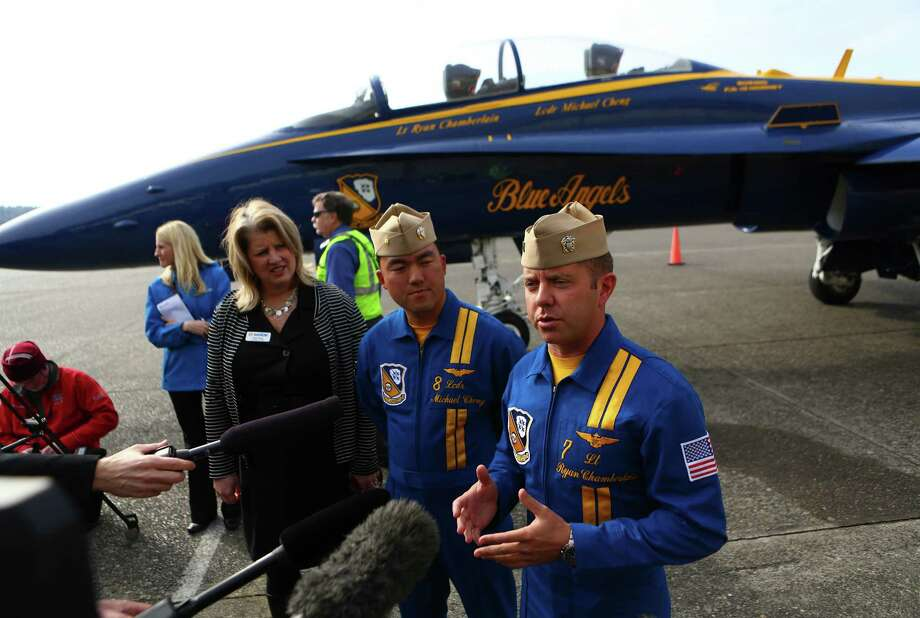 Lt. Cdr. Michael Cheng and Lt. Ryan Chamberlain are interviewed as Blue Angels airplane number seven makes a stop in Seattle. Photo: JOSHUA TRUJILLO, SEATTLEPI.COM / SEATTLEPI.COM