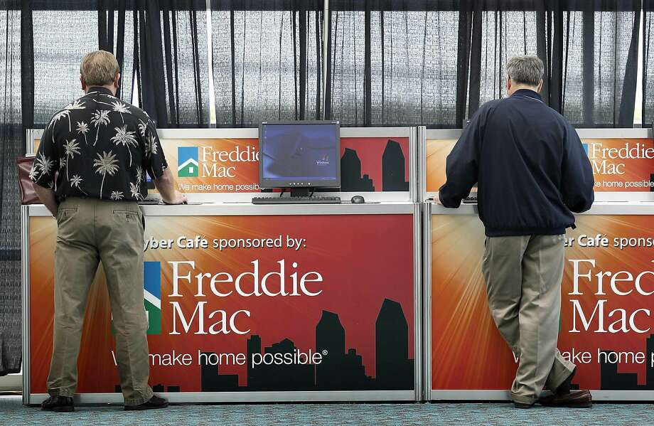 Attendees surf the internet at a Freddie Mac sponsored kiosk at the Independent Community Bankers of America's (ICBA) 2011 Convention in San Diego, California in this file photo taken March 22, 2011. Freddie Mac said on Thursday it will soon send the U.S. Treasury a $10.4 billion dividend after posting a ninth straight quarterly profit, putting taxpayers further into the black on their bailout of the mortgage giant.  REUTERS/Mike Blake/Files     (UNITED STATES - Tags: POLITICS BUSINESS REAL ESTATE) Photo: Mike Blake, Reuters