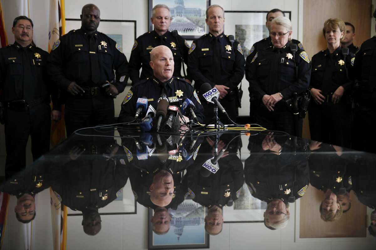 San Francisco Police Chief Greg Suhr, with the SFPD Command Staff standing behind him, speaks during a press conference regarding the five San Francisco police officers and one former San Francisco police officer who have been indicted by a federal grand jury on Thursday, February 27, 2014 in San Francisco, Calif.