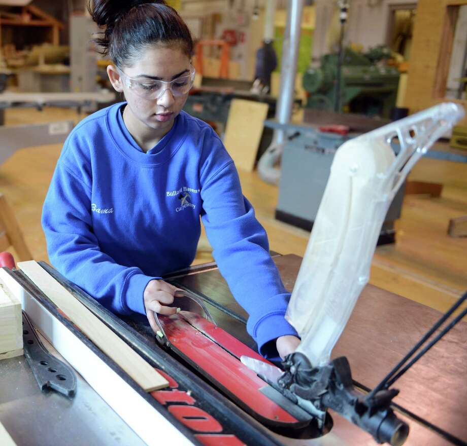 Sophomore Zamarie Rivera adjusts the table saw Thursday, Feb. 27, 2014, during carpentry class at Bullard-Havens technical school in Bridgeport, Conn. Photo: Autumn Driscoll / Connecticut Post