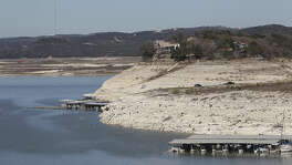 The dropping level of Medina Lake is marked by exposed land in this view from Medina Dam, Tuesday, Feb. 4, 2014. According to today'ÇÖs reading by the Texas Water Development Board, the lake is at 3.5-percent capacity.