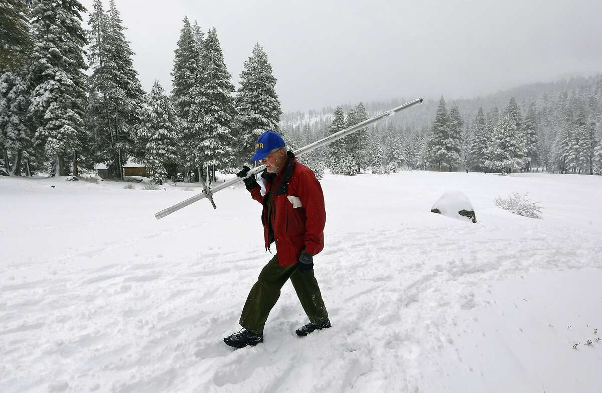 Frank Gehrke, chief of snow surveys for the Department of Water Resources, crosses a snow covered meadow as he conducts the snow survey at Echo Summit Calif. on Thursday, Feb. 27, 2014. The department says its latest survey shows the Sierra Nevada snowpack is still well below normal - bad news for the drought-stricken state. (AP Photo/Rich Pedroncelli)
