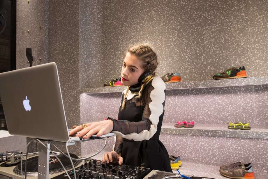 DJ Chelsea Leyland adds a touch of electronica to get the party started at the Valentino opening in San Francisco on Feb. 26, 2014. Photo: Drew Altizer Photography/SFWIRE, Photo: Drew Altizer