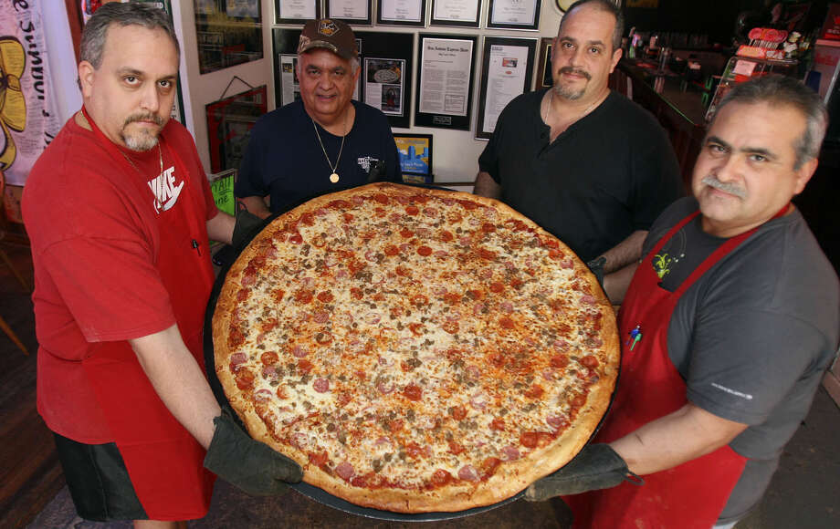 """Big Lou's Pizza:2048 S. W.W. White Road, 210-337-0707, """"Man v. Food"""" introduced the 42-inch pizza to the world. / hmontoya@conexionsa.com"""