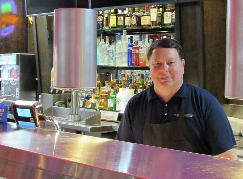 Arthur Mayo helps run Choke Canyon Bar-B-Q, 21510 Blanco Road. The restaurant opened in February. Photo: Burt Henry / San Antonio Express