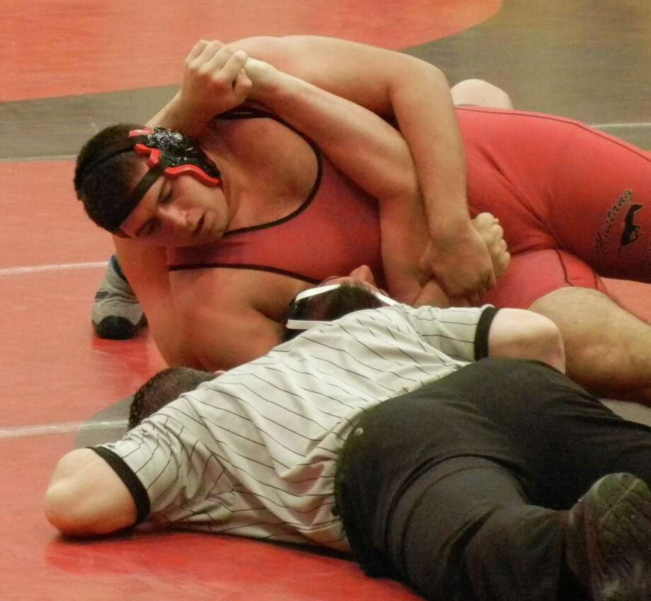 Fairfield Warde's Ahmed Hourani pinning Joseph Fraccaroli, of Wilton, in the 287-pound final on Saturday, Jan. 4 at the Warde Invitational. Photo: Reid L. Walmark / Fairfield Citizen