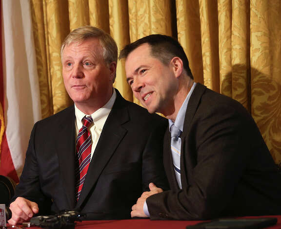 Gay couple from left, Mark Phariss and Victor Holmes, react during a press conference after U.S. Federal Judge Orlando Garcia granted a preliminary injunction for two Texas couples suing the state to st