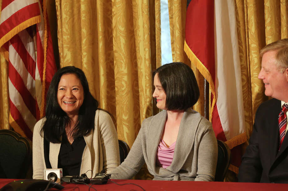 Lesbian couple, from left, Cleopatra De Leon and Nicole Dimetman, react at a press conference after U.S. Federal Judge Orlando Garcia granted a preliminary injunction for two Texas couples suing the state to strike down the gay marriage ban, Wednesday, Feb. 26, 2014. Joining them in the lawsuit were gay couple, Mark Phariss, right, and Victor Holmes, not pictured. Photo: Jerry Lara, San Antonio Express-News / ©2013 San Antonio Express-News