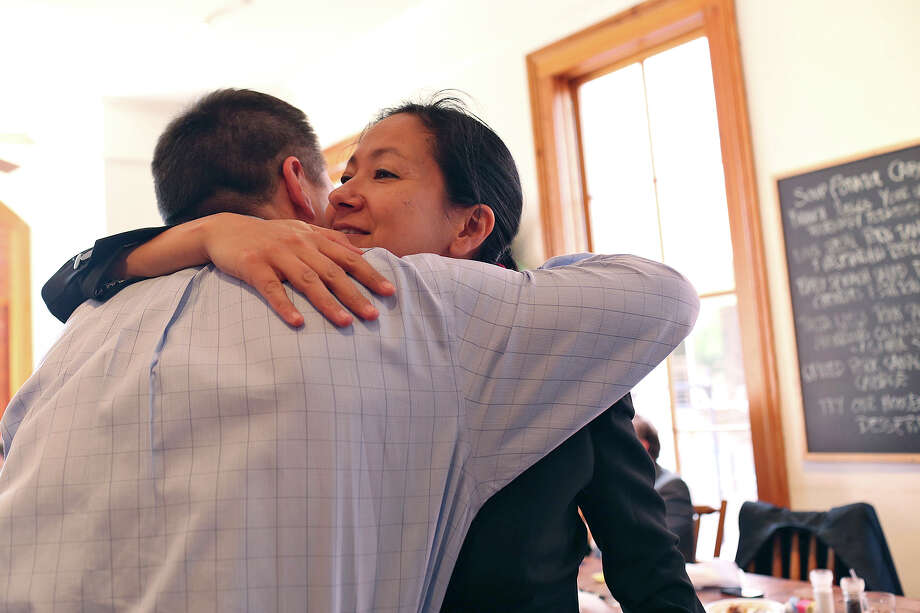 Cleo DeLeon embraces fellow plaintiff, Victor Holmes, after lunch at Liberty Bar with their legal team after the hearing for their request for a preliminary injunction to declare Texas' ban on same-sex marriage unconstitutional at the John H. Wood, Jr. U.S. Courthouse in San Antonio on Wednesday, Feb. 12, 2014. Photo: LISA KRANTZ, Lisa Krantz / SAN ANTONIO EXPRESS-NEWS