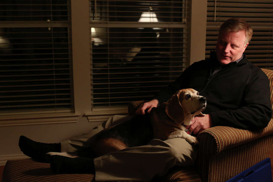 Mark Phariss sits with his dog, Betsy, one of three beagles he shares with his partner, Victor Holmes, at their home in Plano on Friday, Feb. 7, 2014. Photo: Lisa Krantz, San Antonio Express-News / San Antonio Express-News