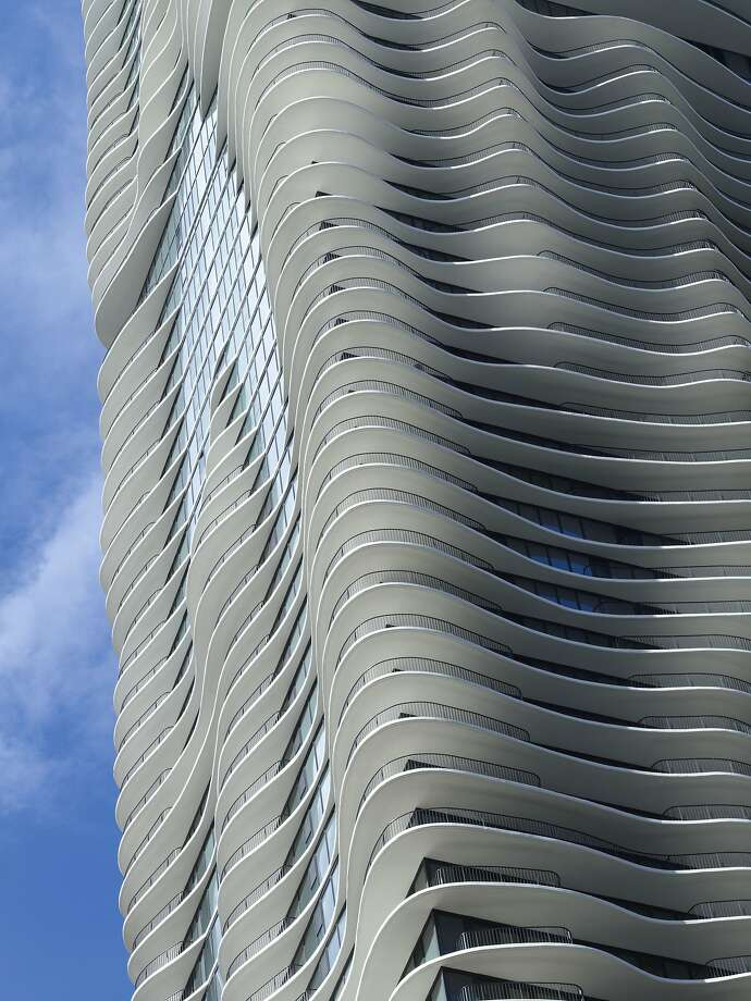 Architect Jeanne Gang's best-known work is Aqua, an 82-story high-rise draped in undulating concrete balconies near Millennium Park in Chicago. Photo: Steve Hall (c) Hedrich Blessing